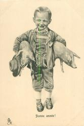boy carries two pigs