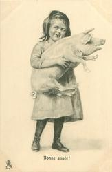 girl carries pig
