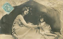 mother seated facing right, looking front holding child's arm, child looks back at her foot