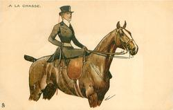 woman in hunting attire rides side-saddle on brown horse, facing right