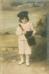 young girl dressed as postman opens her pouch