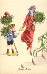 lady in pink buys large bunch of mistletoe from boy