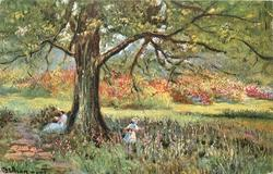 woman seated at foot of tree, reading, child picking flowers